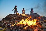 Workers make a living by picking through burning piles of rubbish by Azim Khan Ronnie