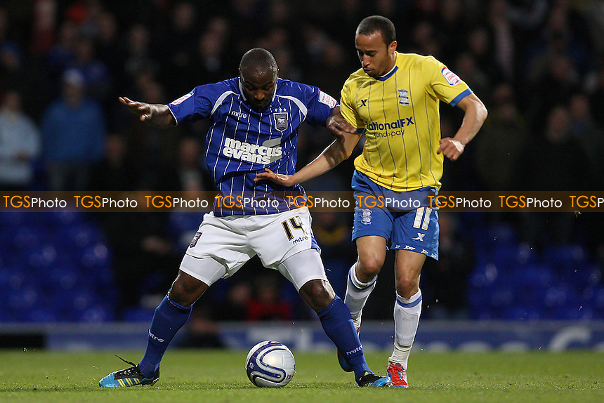 Jason Scotland of Ipswich Town tangles with Andros Townsend of Birmingham City - Ipswich Town vs Birmingham City - nPower Championship Football at Portman Road, Ipswich, Suffolk - 17/04/12 - MANDATORY CREDIT: Gavin Ellis/TGSPHOTO - Self billing applies where appropriate - 0845 094 6026 - contact@tgsphoto.co.uk - NO UNPAID USE.