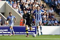 Harry Pell of Colchester United breaks under pressure from Josh Payne of Crawley Town during Colchester United vs Crawley Town, Sky Bet EFL League 2 Football at the JobServe Community Stadium on 13th October 2018