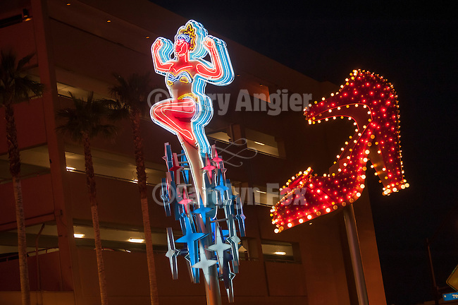Shoe and showgirl neon from the Neon Museum near Fremont Street at night, Las Vegas