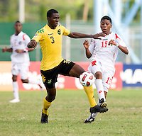 Kemo Wallace (3) of Jamaica tries to take the ball away from Romario Piggott (15) of Panama during the third place game of the CONCACAF Men's Under 17 Championship at Catherine Hall Stadium in Montego Bay, Jamaica. Panama defeated Jamaica, 1-0.