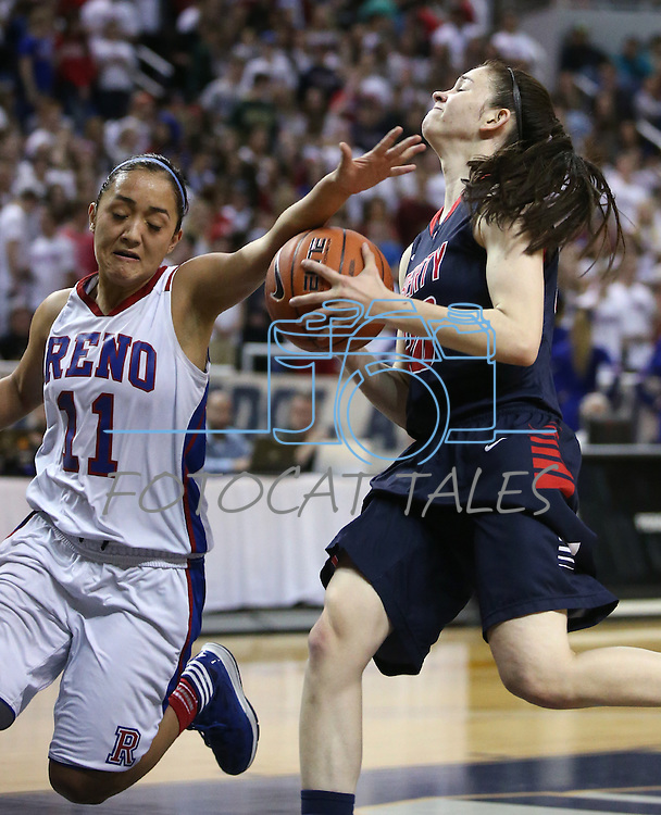 Reno's Daranda Hickey fouls Liberty's Kealy Brown during the Division I championship game in the NIAA basketball state tournament at Lawlor Events Center, in Reno, Nev., on Friday, Feb. 28, 2014. Reno won the state title 50-39. (Cathleen Allison/Las Vegas Review-Journal)