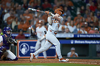 Eric Kennedy (30) of the Texas Longhorns follows through on his swing against the LSU Tigers in game three of the 2020 Shriners Hospitals for Children College Classic at Minute Maid Park on February 28, 2020 in Houston, Texas. The Tigers defeated the Longhorns 4-3. (Brian Westerholt/Four Seam Images)