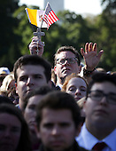 Members of the public watch the arrival ceremony for Pope Francis on the South Lawn of the White House on September 23, 2015 in Washington, DC. The Pope begins his first trip to the United States at the White House followed by a visit to St. Matthew's Cathedral, and will then hold a Mass on the grounds of the Basilica of the National Shrine of the Immaculate Conception. <br /> Credit: Alex Wong / Pool via CNP