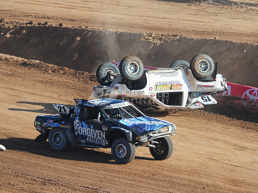 Dec. 11, 2011; Chandler, AZ, USA;  LOORRS super lite driver Jessie Johnson (15) crashes as Brent Fouch passes during the Lucas Oil Challenge Cup at Firebird International Raceway. Mandatory Credit: Mark J. Rebilas-