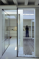 Floor to ceiling glass panels opening on to the inner courtyard fill the kitchen and corridor with natural light