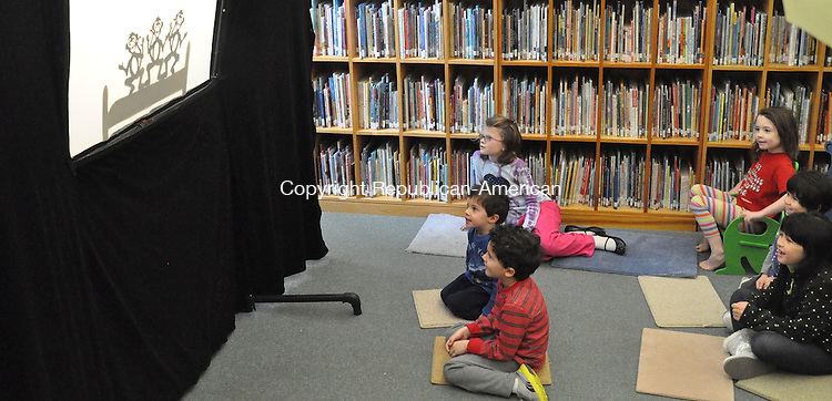 KENT, CT – 27 December 2013 - 122713LMW02 – Children watch intently at the shadow puppet performance Friday at the Kent Memorial Library by Nappy's Puppets. Performer Jim Napolitano of North Haven explained to the children attending that shadow puppets are an ancient form of entertainment. His stories included many songs and children were encouraged to sing along. Lynn Mellis Worthington Republican-American