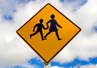 Road traffic sign warning of children crossing, North Island, New Zealand