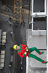 "© Joel Goodman - 07973 332324 . 7 December 2013 . An elf ( JIM GREIG , 50 , from Moston - correct) descends - is this an ""elf and safety"" concern? In scenes reminiscent of a Fathers for Justice demonstration , people in superhero and Christmas-themed costumes , abseil 107 metres down the New York Street side of City Tower to raise money for the Factory Youth Zone in Harpurhey . Photo credit : Joel Goodman"