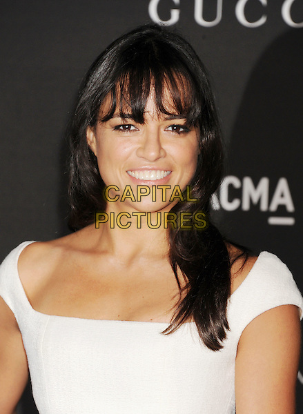 LOS ANGELES, CA - NOVEMBER 01: Actress Michelle Rodriguez attends the 2014 LACMA Art + Film Gala honoring Barbara Kruger and Quentin Tarantino presented by Gucci at LACMA on November 1, 2014 in Los Angeles, California.<br /> CAP/ROT/TM<br /> &copy;Tony Michaels/Roth Stock/Capital Pictures