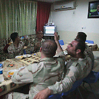 HAWEEYA, DIYALA PROVINCE, KURDISTAN.<br /> A Kurdish Army general remonstrates with the TV whilst watching the Chile versus Spain match during the World Cup. The Haweeya forward operating base houses a combination of Kurdish army and special forces, who are currently battling ISIS militants for control of Jalowla, a city in Diyala Province, 25km down the road.