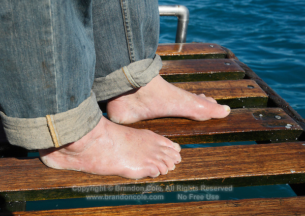 qm0907-D. World famous great white shark expert Andre Hartman's bare feet on the platform at the back of the boat, Dyer Island, Gansbaai, South Africa..Photo Copyright © Brandon Cole. All rights reserved worldwide.  www.brandoncole.com..This photo is NOT free. It is NOT in the public domain. This photo is a Copyrighted Work, registered with the US Copyright Office. .Rights to reproduction of photograph granted only upon payment in full of agreed upon licensing fee. Any use of this photo prior to such payment is an infringement of copyright and punishable by fines up to  $150,000 USD...Brandon Cole.MARINE PHOTOGRAPHY.http://www.brandoncole.com.email: brandoncole@msn.com.4917 N. Boeing Rd..Spokane Valley, WA  99206  USA.tel: 509-535-3489