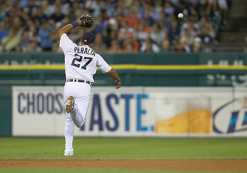 August 03, 2011:  Detroit Tigers shortstop Jhonny Peralta (#27) attempts to catch pop fly during MLB game action between the Texas Rangers and the Detroit Tigers at Comerica Park in Detroit, Michigan.  The Tigers defeated the Rangers 5-4.