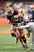 Syracuse Orange quarterback Terrel Hunt (10) is tackled by Boston College Eagles defensive tackle Connor Wujciak (90) during a game at the Carrier Dome on November 30, 2013 in Syracuse, New York.  Syracuse defeated Boston College 34-31.  (Copyright Mike Janes Photography)