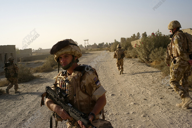 A frontline patrol of  British forces from the Gurkhas B Co. 1RGR and Household Cavalry at Garmsir, Helmand, Afghanistan, November 2007.