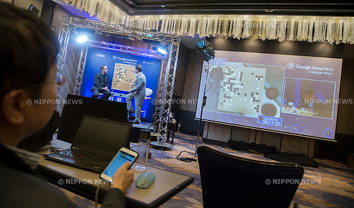 Lee Se-dol, Mar 12, 2016 : South Korean Go master Lee Se-dol playing a human versus computer Go match is seen on a screen during the third match of the Google DeepMind Challenge Match in Seoul, South Korea. Lee beat on Sunday AlphaGo, the artificial intelligence (AI) program made by Google's  DeepMind, for the first time at the fourth match during the special human-versus-computer Go tournament and the five-round Go tournament is now 3-1 as of March 14, 2016, local media reported. (Photo by Lee Jae-Won/AFLO) (SOUTH KOREA)