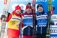 1st January 2020, Toblach, South Tyrol , Italy;  Sergey Ustiugov of Russia, Alexander Bolshunov of Russia and Iivo Niskanen of Finland on the podium after the mens 15 km classic technique pursuit during Tour de Ski on January 1, 2020 in Toblach.