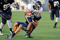 12 August 2011:  FIU's Clinton Taylor (31) attempts to break away from Justin Halley (32) during a scrimmage held as part of the FIU 2011 Panther Preview at University Park Stadium in Miami, Florida.