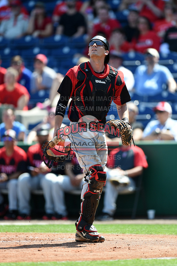 Tampa Spartans catcher Nick Tindall (42) looks for a pop up during an exhibition game against the Philadelphia Phillies on March 1, 2015 at Bright House Field in Clearwater, Florida.  Tampa defeated Philadelphia 6-2.  (Mike Janes/Four Seam Images)