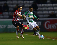 Lincoln City's Bruno Andrade vies for possession with Yeovil Town's Rhys Browne<br /> <br /> Photographer Andrew Vaughan/CameraSport<br /> <br /> The EFL Sky Bet League Two - Lincoln City v Yeovil Town - Friday 8th March 2019 - Sincil Bank - Lincoln<br /> <br /> World Copyright © 2019 CameraSport. All rights reserved. 43 Linden Ave. Countesthorpe. Leicester. England. LE8 5PG - Tel: +44 (0) 116 277 4147 - admin@camerasport.com - www.camerasport.com