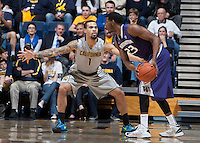 Justin Cobbs of California in defense mode during the game against Washington at Haas Pavilion in Berkeley, California on January 15th 2014.  California defeated Washington, 82-56.