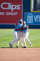 Spokane Indians outfielders Starling Joseph (39), Tanner Gardner (44), and Julio Pablo Martinez (27) celebrate after clinching their Division after a Northwest League game against the Vancouver Canadians at Avista Stadium on September 2, 2018 in Spokane, Washington. The Spokane Indians defeated the Vancouver Canadians by a score of 3-1. (Zachary Lucy/Four Seam Images)