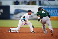 Tampa Yankees shortstop Gleyber Torres (11) waits for a throw as Chad Tromp (4) starts a slide into the bag during a game against the Daytona Tortugas on August 5, 2016 at George M. Steinbrenner Field in Tampa, Florida.  Tampa defeated Daytona 7-1.  (Mike Janes/Four Seam Images)