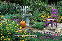 63821-12517 Fall Garden Display - Purple chair, pumpkin, bird bath & fence in flower bed  Marion Co.  IL