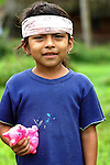 A girl with bandana and doll in the Mayan village of Crique Sarco, Belize.