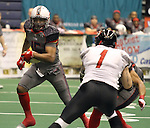 SIOUX FALLS, SD - MAY 18:  Quarterback Terrance Bryant #15 from the Sioux Falls Storm looks for running room past xxxxxxx #1 from the Chicago Slaughter in the first half of their game Saturday night at the Sioux Falls Arena.  (Photo by Dave Eggen/Inertia)