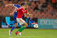 Israel's Eytan Tibi (back) and Hungary's Adam Szalai (front) fight for the ball during a friendly football match Hungary playing against Israel in Budapest, Hungary on August 15, 2012. ATTILA VOLGYI