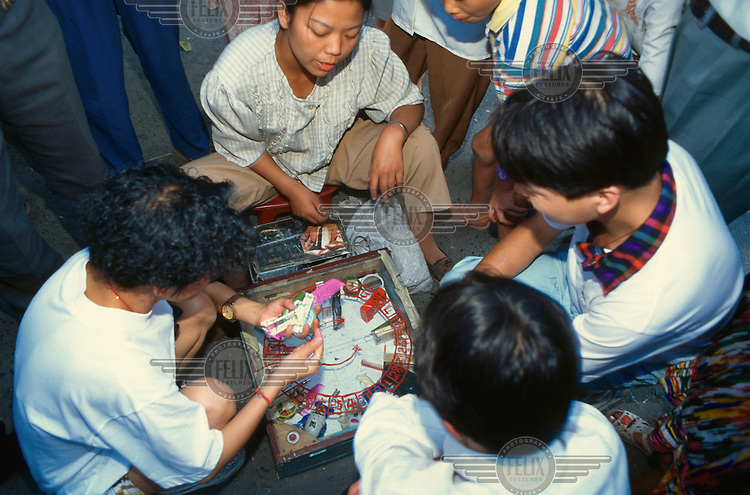 © Marcus Rose / Panos Pictures..CHINA..Gambling on the street.
