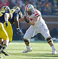 Ohio State Buckeyes offensive linesman Pat Elflein (65) against Michigan Wolverines during their college football game at Michigan Stadium in Ann Arbor, Michigan on November 30, 2013.  (Dispatch photo by Kyle Robertson)