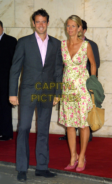LANCE GERRARD WRIGHT, ULRIKA JONSSON.Nordoff-Robbins Silver Clef Awards at the Hotel Inter-Continental.www.capitalpictures.com.sales@capitalpictures.com.© Capital Pictures..full length, full-length, wrap dress, floral print, funny, pink slingbacks, slingback heels