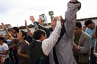 South America, Argentina, Buenos Aires, Los Olmos, Evangelism - Led by Christian prisoners, these visiting international missionaries praise and worship along side the incarcerated of Los Olmos Prison, Unit 25, July 2006, &copy;Stephen Blake Farrington<br />