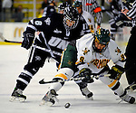 1 February 2008: University of New Hampshire Wildcats' forward Greg Collins, a Junior from Fairport, NY, checks University of Vermont Catamounts' forward Wahsontiio Stacey, a Freshman from Kahnawake, Quebec, at Gutterson Fieldhouse in Burlington, Vermont. The seventh-ranked Wildcats defeated the Catamounts 5-1in front of a sellout crowd of 4,003...Mandatory Photo Credit: Ed Wolfstein Photo
