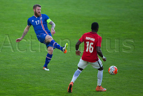 01.06.2016  Ullevaal Stadion, Oslo, Norway.  Aron Gunnarsson of Iceland with a through pass past Diomande of Norway during the International Football Friendly match between Norway versus Iceland at  Ullevaal Stadion in Oslo, Norway.
