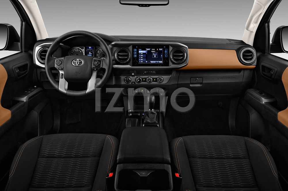 Stock photo of straight dashboard view of a 2016 Toyota Tacoma SR5 Access Cab 4 Door Pick Up