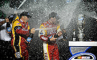 Nov. 15, 2008; Homestead, FL, USA; NASCAR Nationwide Series driver Clint Bowyer (right) is sprayed with champagne as he celebrates after winning the 2008 championship following the Ford 300 at Homestead Miami Speedway. Mandatory Credit: Mark J. Rebilas-