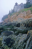 Bass Harbor Head Lighthouse sits in the fog rolling off the Atlantic Ocean, Acadia National Park, Hancock County, Maine