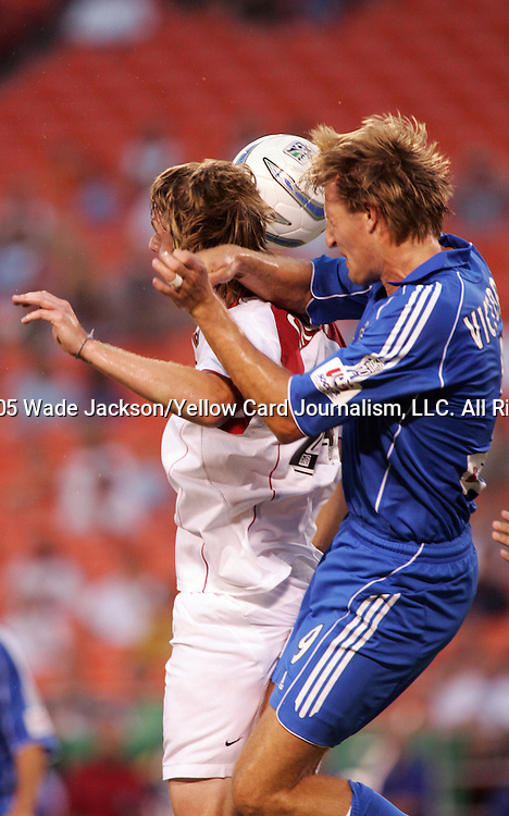 10 September 2005,  Eddie Gaven (L) of the MetroStars and Sasha Victorine (R) of the Wizards battled the entire match.  Gaven was given credit for the game winning goal from a deflection by Victorine...The MLS Kansas City Wizards were defeated by the MetroStars by a score of 0-1 at Arrowhead Stadium, Kansas City, Missouri...