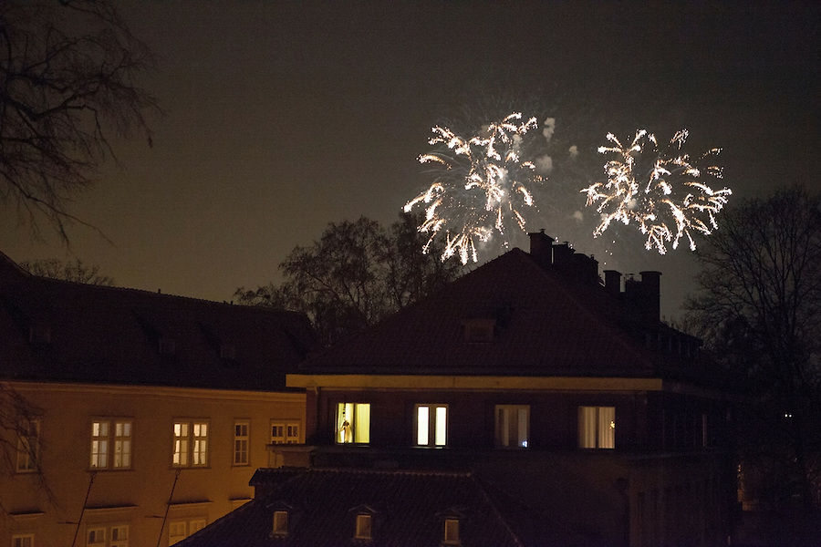 Fireworks over rooftops in Mala Strana, Prague, Czech Republic, Europe