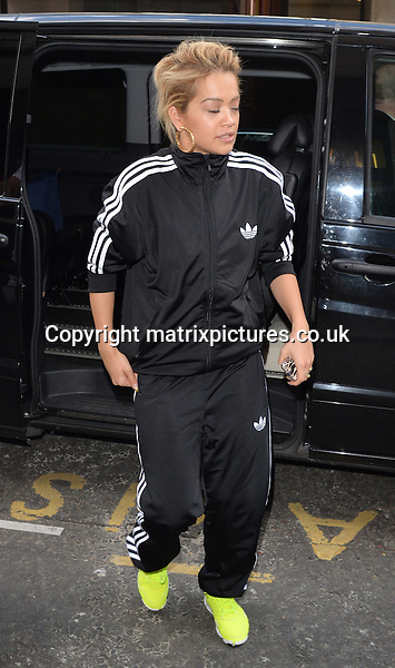 NON EXCLUSIVE PICTURE: PALACE LEE / MATRIXPICTURES.CO.UK<br /> PLEASE CREDIT ALL USES<br /> <br /> WORLD RIGHTS<br /> <br /> British singer and actress Rita Ora is pictured during a visit to a recording studio in West London. <br /> <br /> The 23 year old wears a black adidas tracksuit and a pair of neon trainers.<br /> <br /> MAY 14th 2014<br /> <br /> REF: LTN 142296