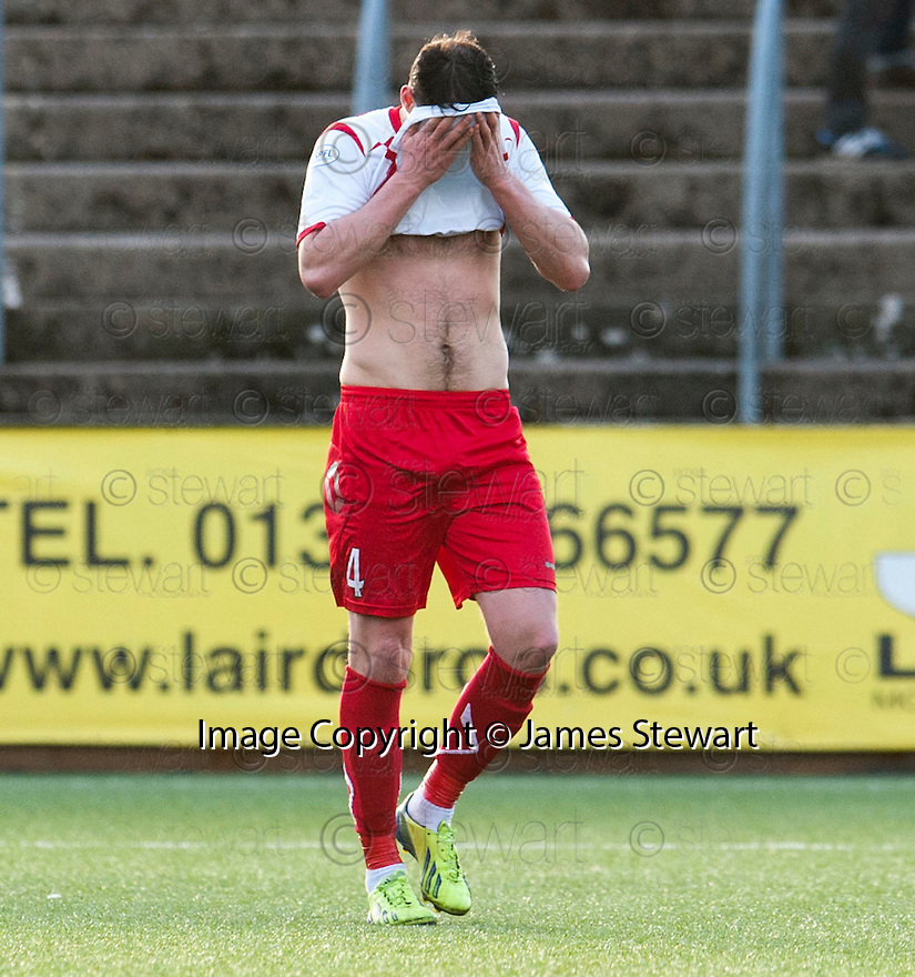 A dejected Stranraer's Scott Robertson at the end of the game.