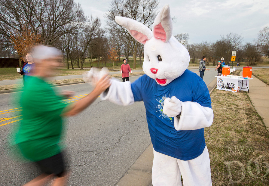 NWA Democrat-Gazette/BEN GOFF @NWABENGOFF<br /> Emily Glenn of Cave Springs, dressed as the Easter bunny, encourages runners at an aid station Saturday, March 23, 2019, during a half marathon training run at Memorial Park in Bentonville. Volunteers from Flagstone Church of Christ in Bentonville set up the aid station as participants in the Run Bentonville Half Marathon training program took their final group run before the March 30 half marathon. The training program, run by Mike Rush of Rush Running Company, has been preparing runners with clinics and group runs since December. Flagstone Church of Christ was also promoting their Jack Rabbit 5K, set for April 13, which works with Rush Running Company to donate shoes to local families in need.