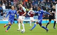 Burnley's Jack Cork passes under pressure from Leicester City's Ricardo Pereira<br /> <br /> Photographer Rich Linley/CameraSport<br /> <br /> The Premier League - Burnley v Leicester City - Saturday 16th March 2019 - Turf Moor - Burnley<br /> <br /> World Copyright © 2019 CameraSport. All rights reserved. 43 Linden Ave. Countesthorpe. Leicester. England. LE8 5PG - Tel: +44 (0) 116 277 4147 - admin@camerasport.com - www.camerasport.com