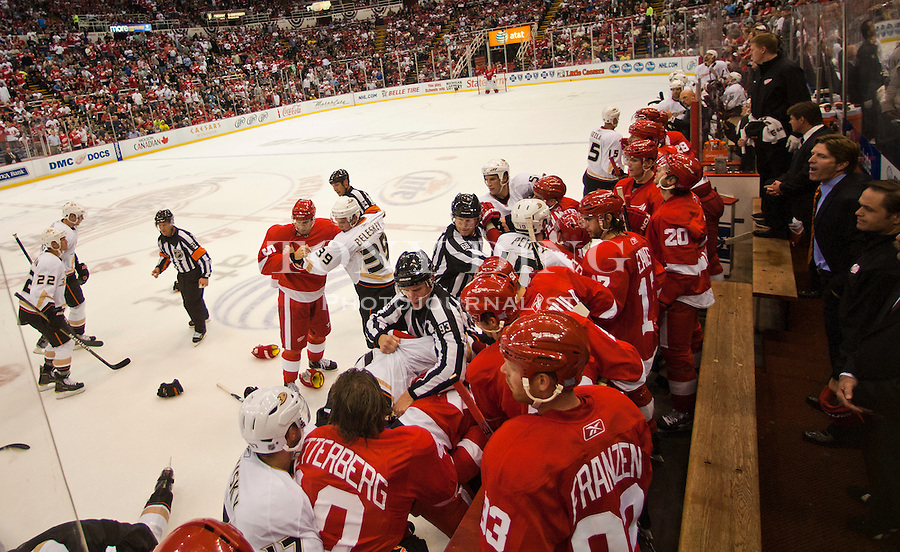 8 October 2010: Referees attempt to break up a fight against the benches in the second period of the Anaheim Ducks at Detroit Red Wings NHL hockey game, at Joe Louis Arena, in Detroit, MI...***** Editorial Use Only *****