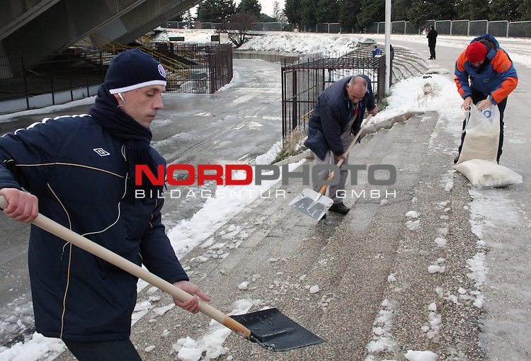 Football player Ante Bilic cleans the remains of snow in front of the Poljud Stadium in Split, February 8, 2012. The heavy snow storm that hit the city during the weekend has caused significant problems in traffic and has blocked the city for two days. Over 30 cm of snow that have fallen on the city is the biggest amount of snow in the history of Split. <br /> <br /> Foto &copy;  nph / PIXSELL / Ivana Ivanovic