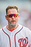 15 June 2016: Washington Nationals 3rd base coach Bob Henley watches play from the dugout during game action against the Chicago Cubs at Nationals Park in Washington, DC. The Nationals defeated the Cubs 5-4 in 12 innings to take the rubber match of their 3-game series. Mandatory Credit: Ed Wolfstein Photo *** RAW (NEF) Image File Available ***