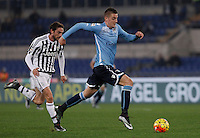 Calcio, Serie A: Lazio vs Juventus. Roma, stadio Olimpico, 4 dicembre 2015.<br /> Lazio&rsquo;s Sergej Milinkovic-Savic, right, is chased by Juventus&rsquo; Claudio Marchisio during the Italian Serie A football match between Lazio and Juventus at Rome's Olympic stadium, 4 December 2015.<br /> UPDATE IMAGES PRESS/Isabella Bonotto